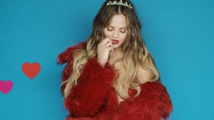 Chrissy Teigen gives everyone a Valentines gift with her near nekked video