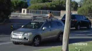 Crazy footage shows a mother driving with her son sitting on the roof rack!